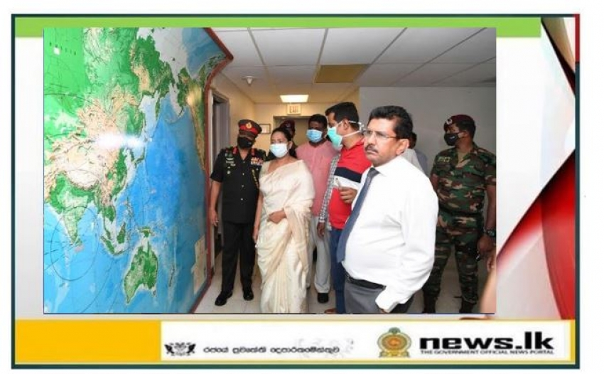 Government delegation inspecting the buildings during work in progress. Sri Lanka, Iranawila